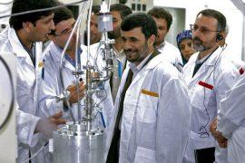 Iranian President Mahmoud Ahmadinejad inspects the Natanz nuclear plant in central Iran